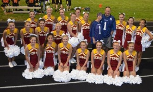 The Dalles High School Cheerleaders along with Derek and Misty Martin