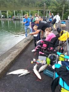 Abby fishing with Jojo,  dad and Papa