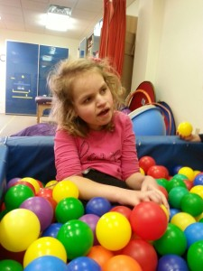 Abby playing in the ball pit