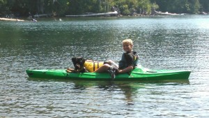 a boy, his kayak and his dog